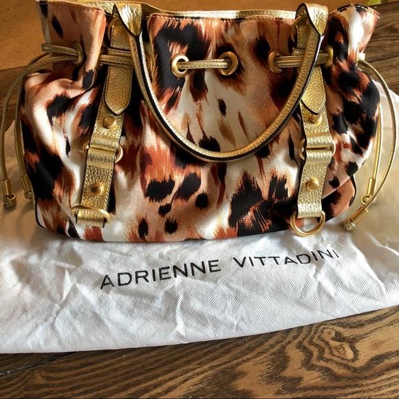 Adrienne Vittadini Handbags - SALE: Adrienne Vittadini Cheetah print gold purse